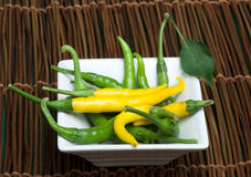 Small thin green chili peppers Stock Photos