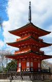 Small three story pagoda in traditional Buddhist style at Kiyomizu-dera historical site in Kyoto. Historical architecture of a traditional red and white Buddhist Royalty Free Stock Image