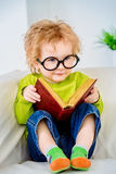 Boy is reading stock image