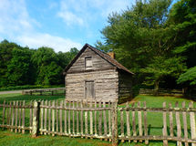 A small, tidy cabin built by pioneers in virginia. An example of a house built by early settlers in the blue ridge mountains Royalty Free Stock Photos
