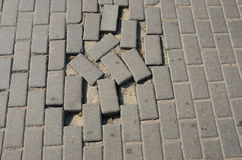Small tiled sidewalk without few ones. Stock Images