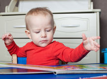 Small toddler or a baby child playing with puzzle shapes on a lo royalty free stock photo