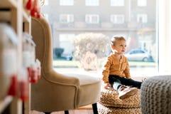 A small toddler boy sitting in zero waste shop. Copy space. A happy small toddler boy sitting in zero waste shop. Copy space stock photos