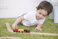 Small toddler in a colorful children room in a nursery or preschool. child boy playing with toys indicators at home Royalty Free Stock Photos