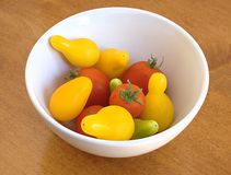 Small tomato assortment in white bowl Royalty Free Stock Image