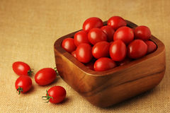 Small Tomato. Small cherry tomatoes in a wooden bowl. Tomato is rich in Lycopene antioxitant Stock Photos