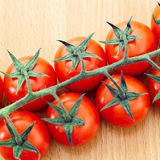Small tomatoes Stock Images