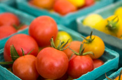 Small tomatoes in boxes at the market Stock Photo