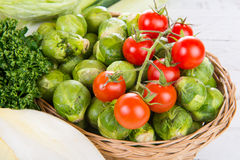 Small tomatoes and brussels sprouts Royalty Free Stock Photos