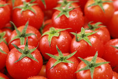 Small tomatoes forming a background Stock Photo