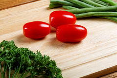 Small tomatoes and salad leaves Royalty Free Stock Photography