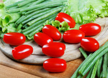 Small tomatoes and salad leaves Royalty Free Stock Images