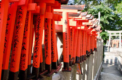 Small torii gates at a shrine in Kyoto. Small torii gates at the fushimi inari shrine in kyoto Royalty Free Stock Image