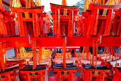 Small Torii gates with written wishes and offerings made of smal Stock Photos