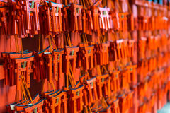 Small torii with prayers and wishes at Fushimi Inari Shrine. Defocused detail of wishes and prayers written on small red torii at the entrance to Fushimi Inari Royalty Free Stock Images