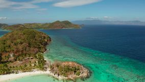 Small torpical island with white sandy beach, top view. Aerial seascape tourists enjoy the tropical beach. tropical island with sand beach, palm trees stock video
