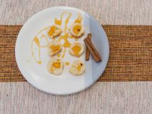 Small torrads accompanied by honey and cinnamon on white plate. Healthy food, small slices of toast with honey and cinnamon Royalty Free Stock Image