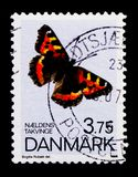 Small Tortoiseshell Aglais urticae, utterflies serie, circa 1993. MOSCOW, RUSSIA - OCTOBER 3, 2017: A stamp printed in Denmark shows Small Tortoiseshell Aglais Stock Image