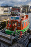 A small tour boat in the Harbor of Bergen Stock Photography