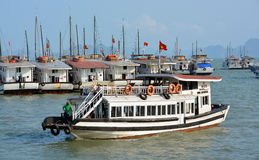 Small Tourist Boat aarives in Halong Bay Marina. Royalty Free Stock Photos