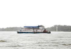 Small tourist boats sailing in Mandovi river Royalty Free Stock Photos