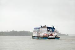 Small tourist boats sailing in Mandovi river Royalty Free Stock Image