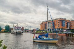 Small tourist catamaran ship and a yacht in Gdansk, Poland. Small tourist ship with two hulls and a yacht on Motlawa canal on old harbor in Gdansk, northern Stock Photos