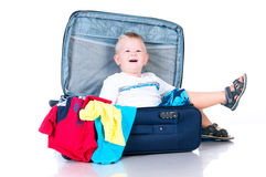 Small tourist collects things in a suitcase for travel Royalty Free Stock Photography