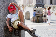 Small boy tourist rests Royalty Free Stock Photos