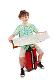 Small tourist with a suitcase and a map Stock Photos