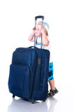 Small tourist with suitcase on white background Stock Photo
