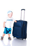 Small tourist with suitcase on white background Stock Photos