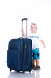 Small tourist with suitcase on white background Royalty Free Stock Photography