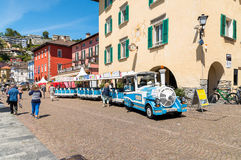 Small tourist train in the historical center of Ascona. Stock Photos