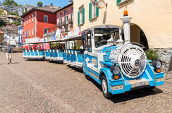 Small tourist train in the historical center of Ascona. Stock Images