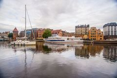 Sailboat and a tourist ship in Gdansk, Poland. Small tourist and a yacht on Motlawa canal on old harbor in Gdansk, northern Poland Royalty Free Stock Photo
