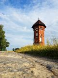 Small tower of bricks on the road Stock Images