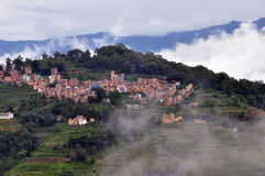 Small town above clouds and fields. A small town in the mist, looks like above clouds and terraced fields Royalty Free Stock Images