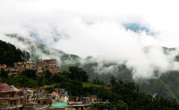 Small town above clouds. A small town in the mist, looks like above clouds stock image