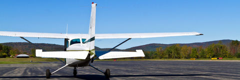 Small town airfield. Banner view of small propeller airplane waits on runway at Pittsfield, Massachusetts, airfield Stock Image