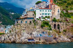 Small town of Amalfi village with colorful houses, located on rock, Amalfi Mediterranean coast with Gulf of Salerno, Campania, Ita. Wonderful Italy. Small town stock image