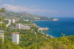 Small town on the Black Sea coast against blue sky with clouds. Royalty Free Stock Photos
