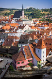 The small town of Cesky Krumlov seen from the castle hill. Cesky Krumlov, a small town in the Czech Republic, seen from its castle hill, with a church in the royalty free stock image