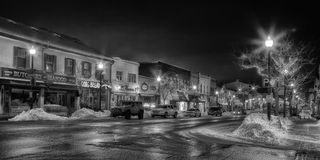 Small Town Christmas Street B&W. A back and white wintery view of downtown Oakville at night during Christmas time Royalty Free Stock Photo
