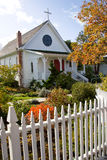 Small Town Church with picket fence. A small white quaint christian church with white picket fence Royalty Free Stock Photography
