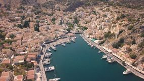 Small town with colorful houses on Symi island stock video footage