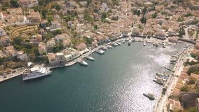 Small town with colorful houses on Symi island stock footage