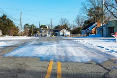 Icy roads. A small town covered in icy roads royalty free stock photos