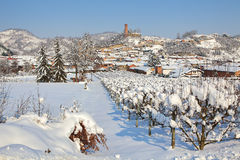 Small town covered by snow in Piedmont, Italy. Royalty Free Stock Photos