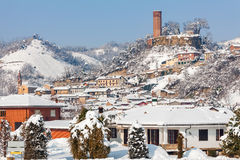Small town covered with snow in Piedmont, Italy. Stock Images